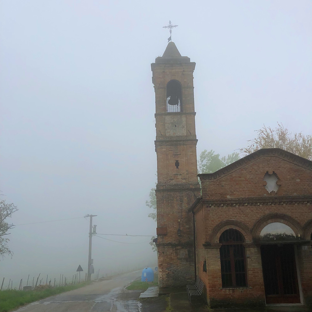 Foggy weather in Piemonte and a medieval church in the rain in Alessandria