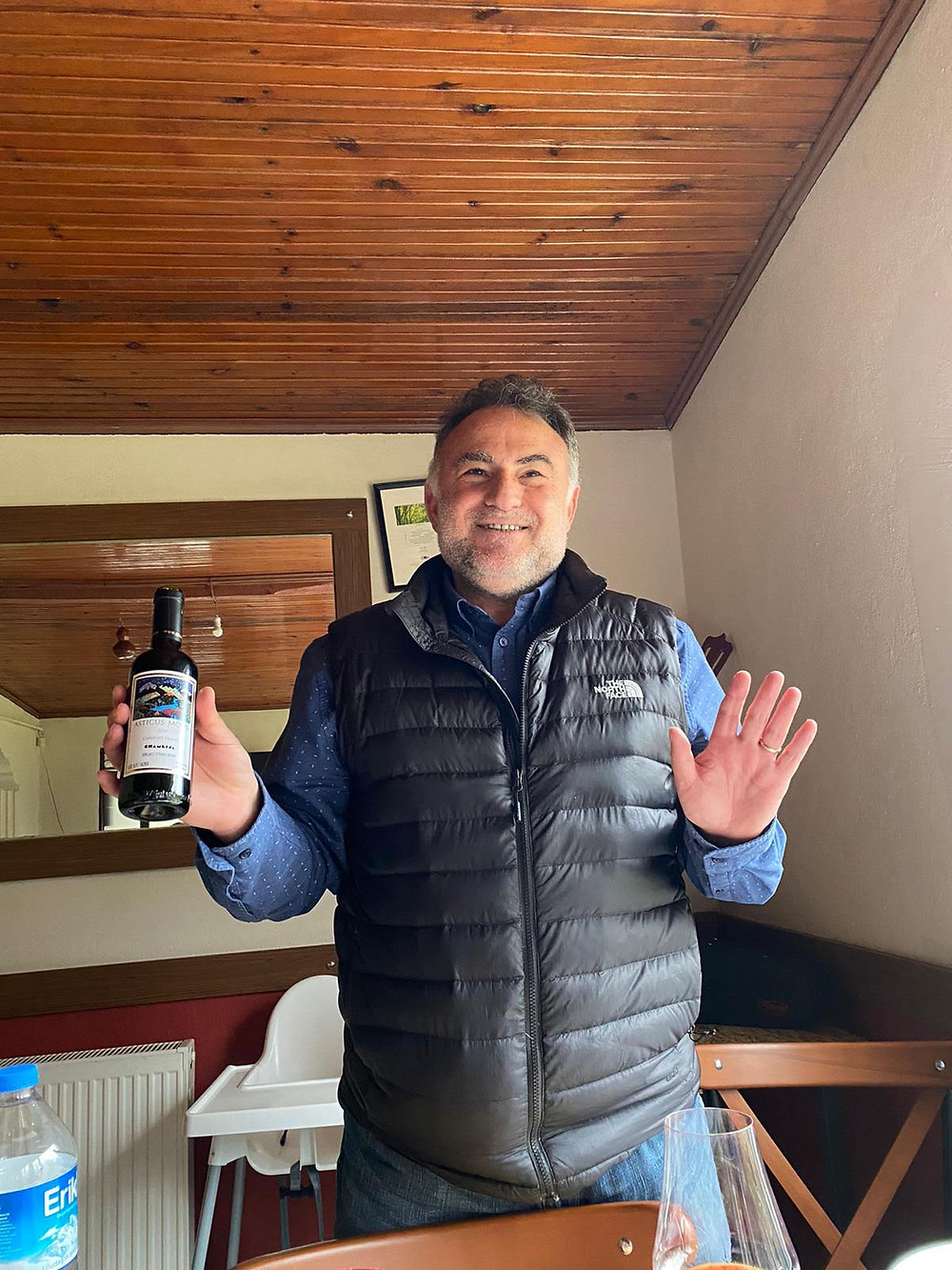 Mustafa Camlica holding Asticus Mons Cabernet Franc during a wine tasting at Chamlija winery on a winery visit