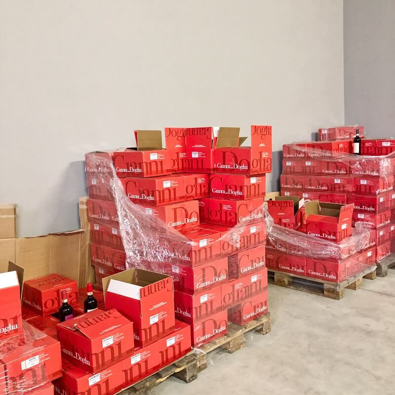 wine warehouse with cases of wine bottles of Moscato d'Asti wine at Gianni Doglia winery