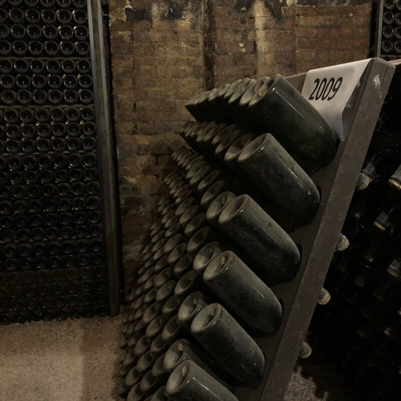 wine cellar and sparkling wine bottles ageing in the UNESCO Cathedrals in Canelli, Contratto winery