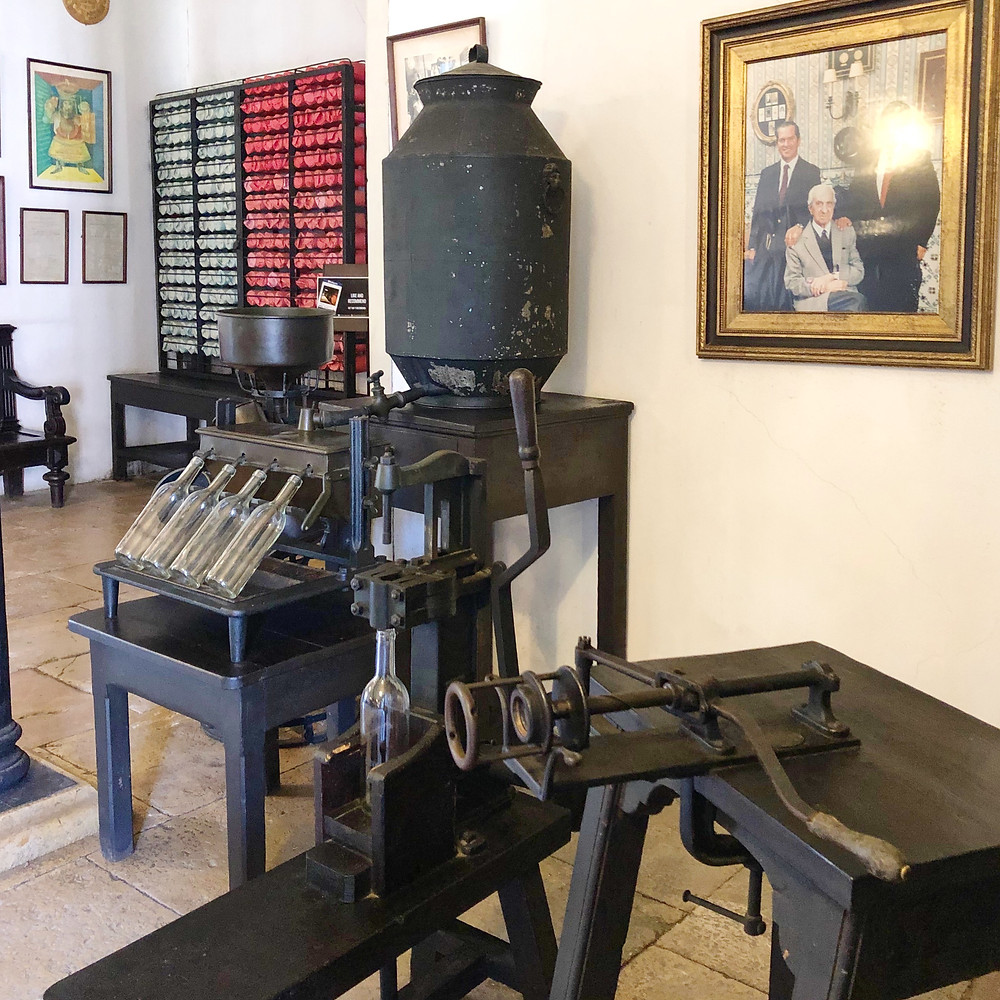 oldest in Portugal wine bottling machine during winery tour and visit to visit José Maria da Fonseca winery