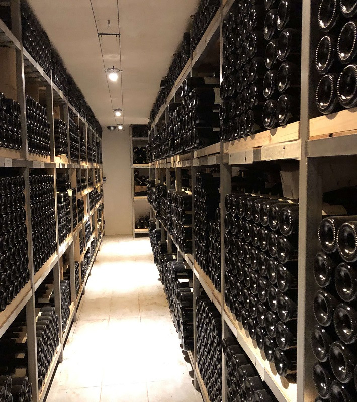 Wine library with all vintages of Elio Altare at the Altare winery in La Morra Barolo DOCG during a winery tour
