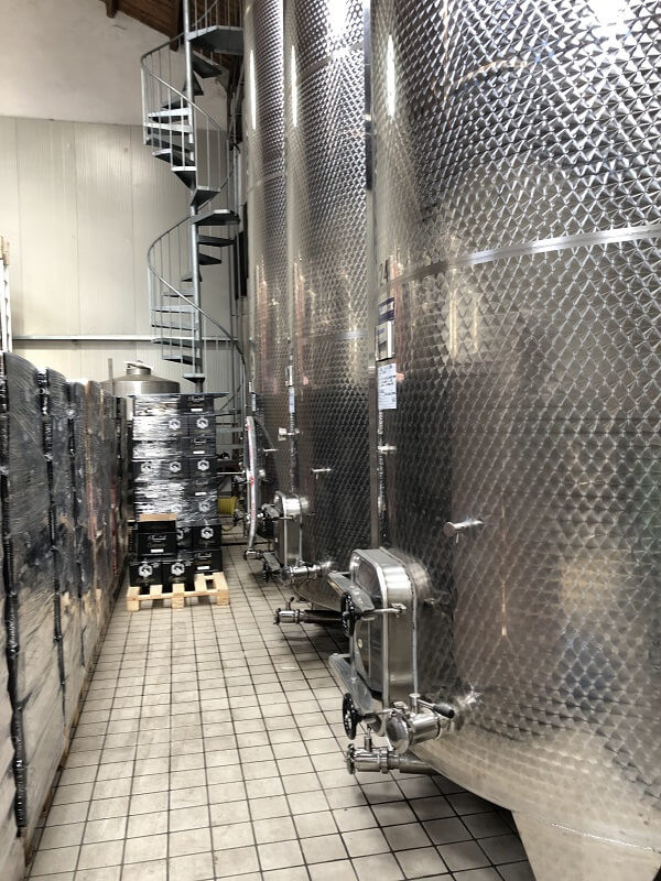 stainless steel fermentation tanks in Contratto winery in Canelli Piemonte during a wine tasting and tour