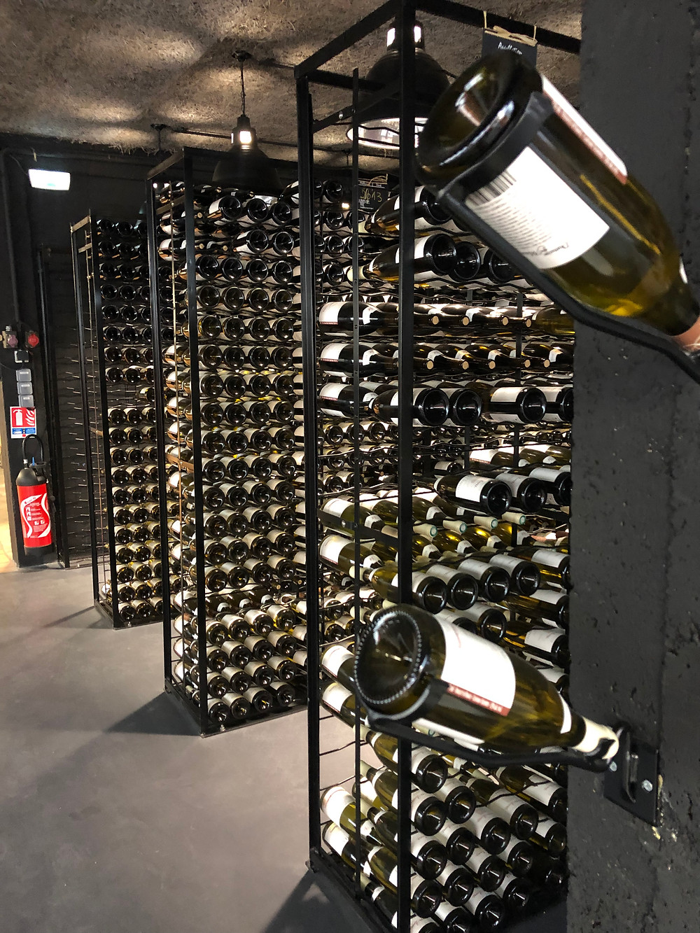wine racks in a Chablis wine cellar at Domaines des Malandes in Chablis village in Burgundy