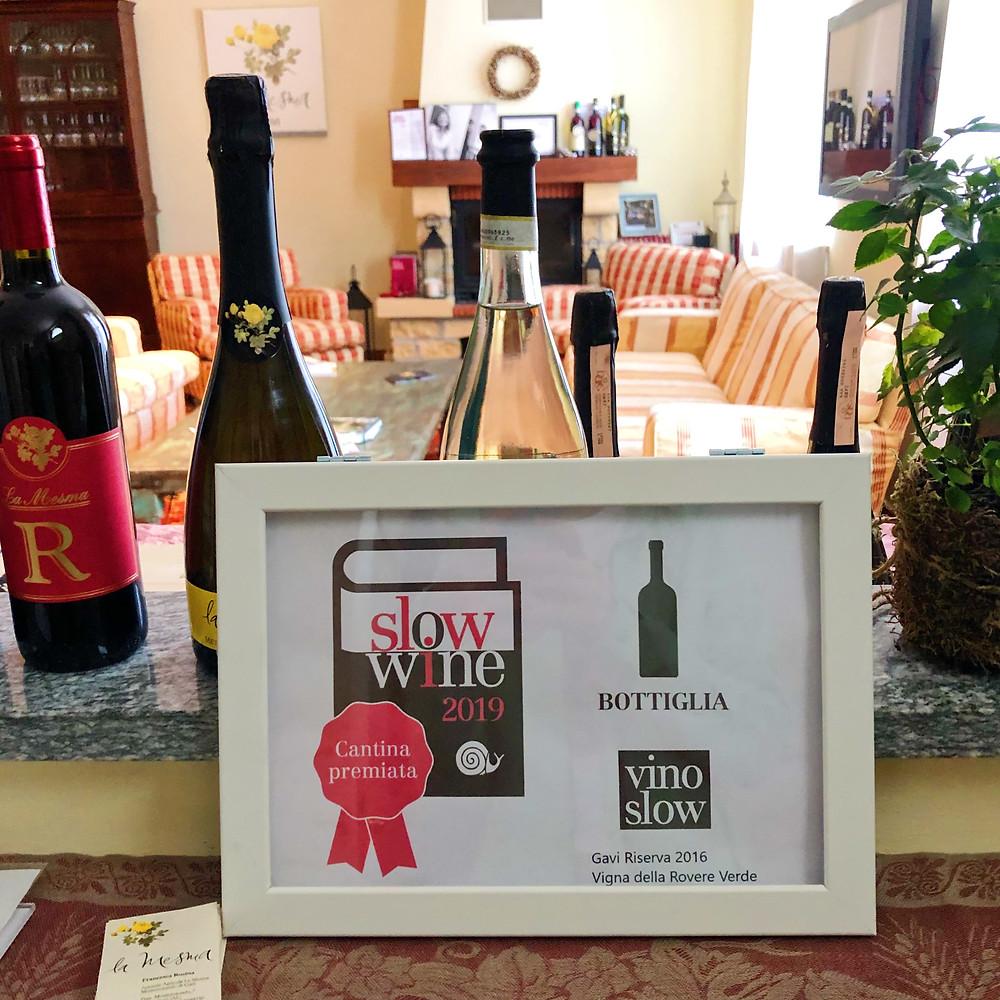 Frame with a certificate of Slow wine award for La Mesma Gavi Riserva DOCG vino slow in the winery's tasting room