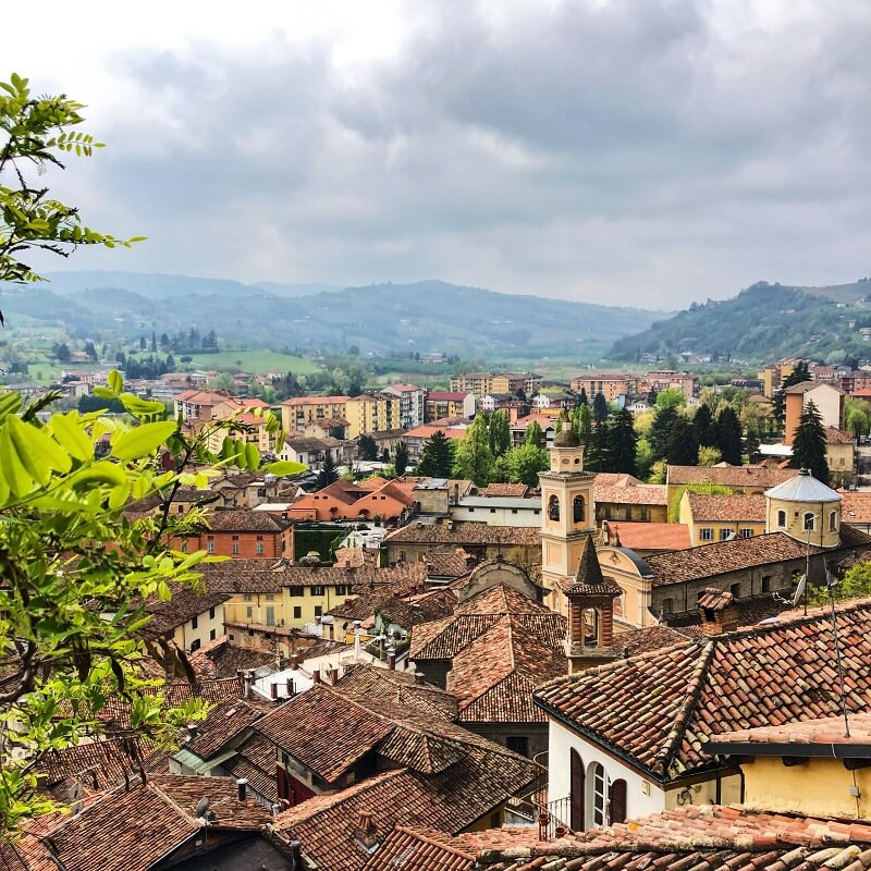 view from the hills over the rooftops and mountains of Canelli town the centre of Alta Langa DOCG metodo classico wines