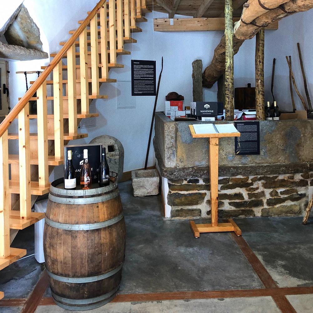 wine tasting experience in Lisbon with an old grape wine press in Manz Wine tasting room in Cheleiros Lisbon wine region