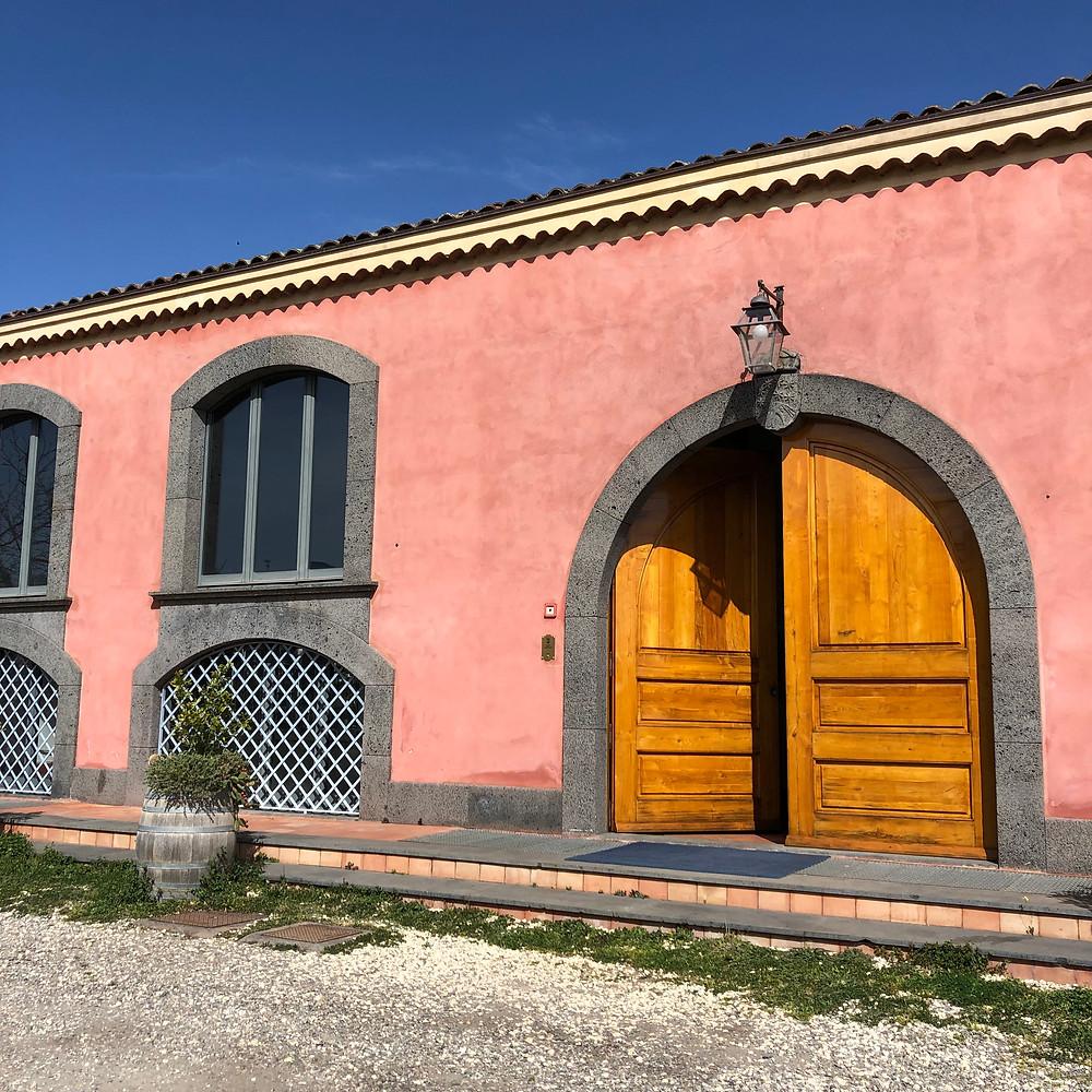 pink coloured wine cellar in Tenuta Terre Nere winery in Etna wine region Sicily