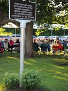 Historic Register sign greets concert goers
