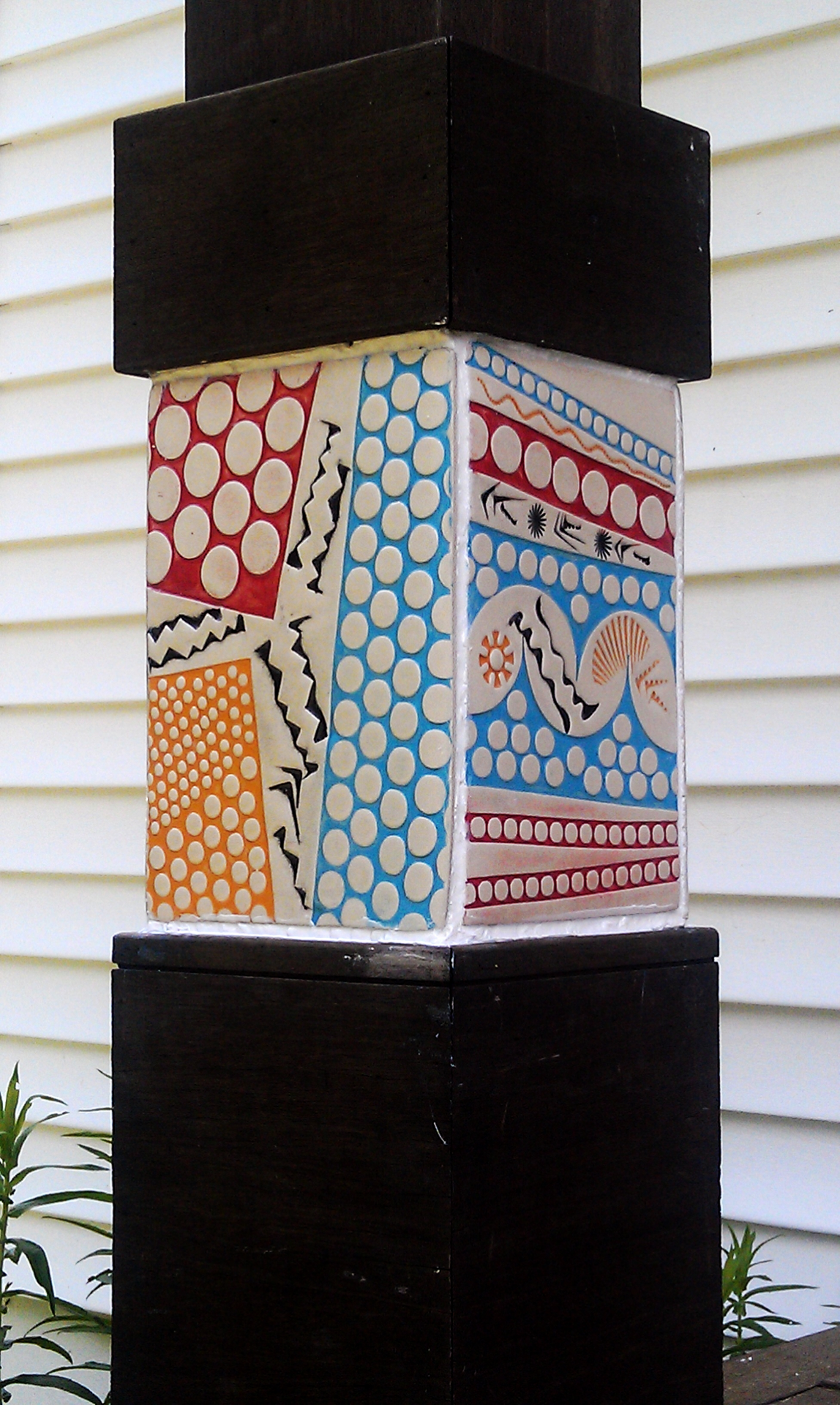Pastel tiles on porch column