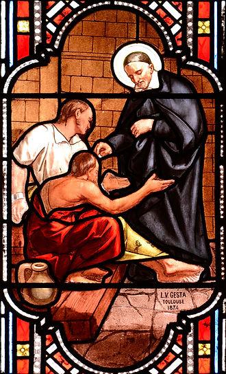 St Vincent de Paul serving the poor