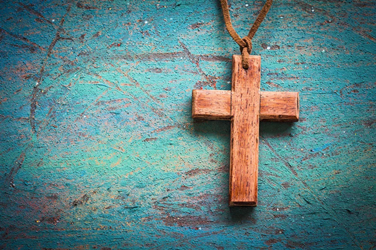wooden cross on retro background - purch