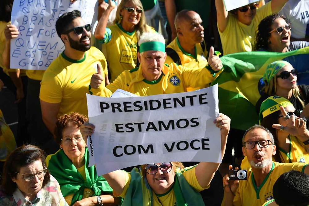 Cidadãos na manifestação pro-Bolsonaro no dia 26 de maio