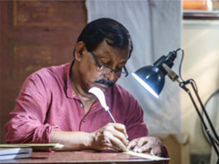 Making of the palm leaf engraving showing stories of Gita Govind