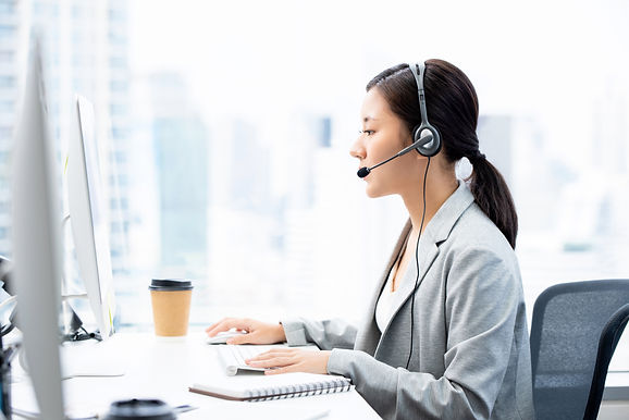young-asian-businesswoman-wearing-headsets-working-call-center-city-office-as-telemarketin