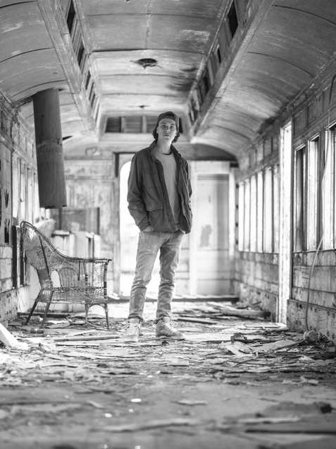 man, abandoned train, black and white, portrait, sex