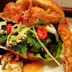 Braised pork belly burger, with a chilli, ginger, honey glaze. Plumb sauce, crispy fennel crackling,