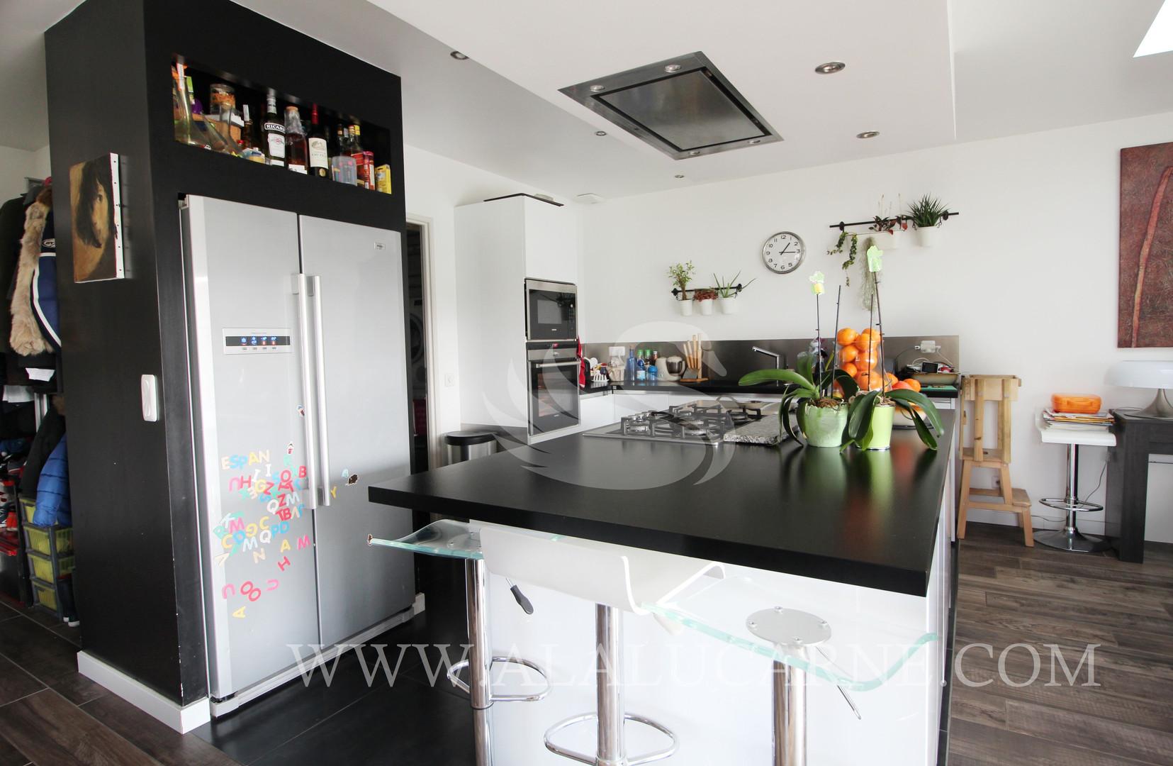 A_vendre_maison_avec_salon_séjour_cuisi
