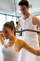 Exercise Physiologist helping woman with strength training