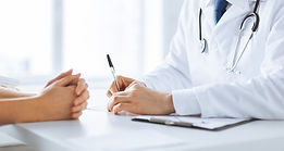 close up of patient and doctor taking notes.jpg