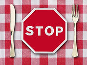 stop on tablecloth with knife and fork.j