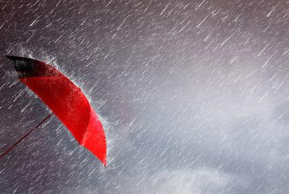 Red umbrella against the storm,sky backg
