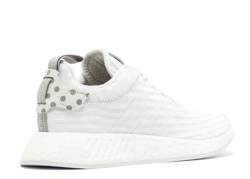 2373ae0b54a85 The adidas NMD R2 is a new low-top sneaker from adidas Originals. It is the  second version of the adidas NMD R1 and features a mix of Primeknit
