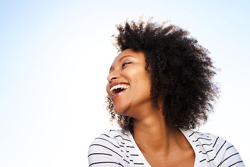 cheerful-young-black-woman-laughing-outd