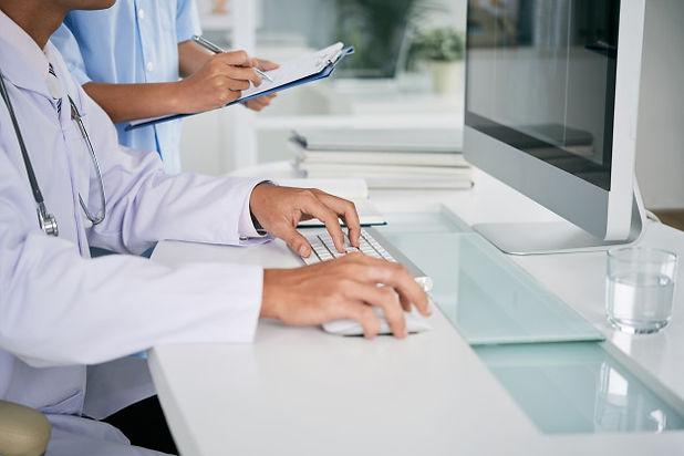doctor-working-computer_1098-16465.jpg