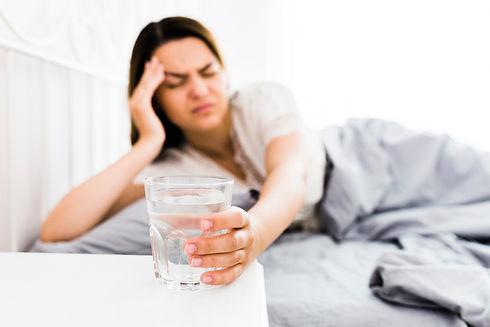 female-suffering-from-headache-taking-gl