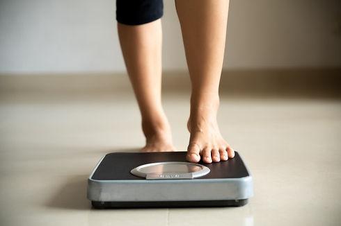 female-leg-stepping-weigh-scales-healthy