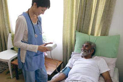 asian-female-nurse-checking-blood-pressu