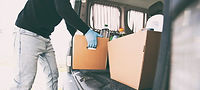 courier-takes-cardboard-eco-box-with-pro