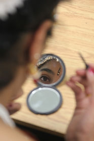 A dancer getting ready for a stage show