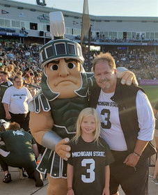 Reagan Dad and SParty on the field
