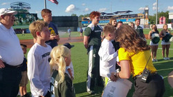 Sparty helping Cameron from Sparty Kids throw out the first pitch for the WhiteCaps Rivalry Night