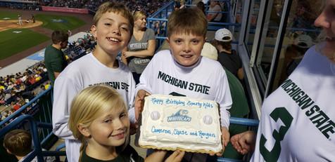 Reagan Chase and Cameron enjoying their Birthday cake