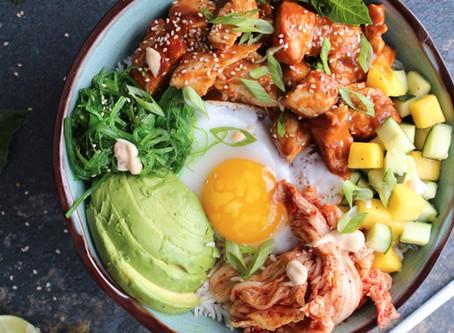 korean chicken bowl with green mandarin cucumber-mango salad and spicy mayo sauce