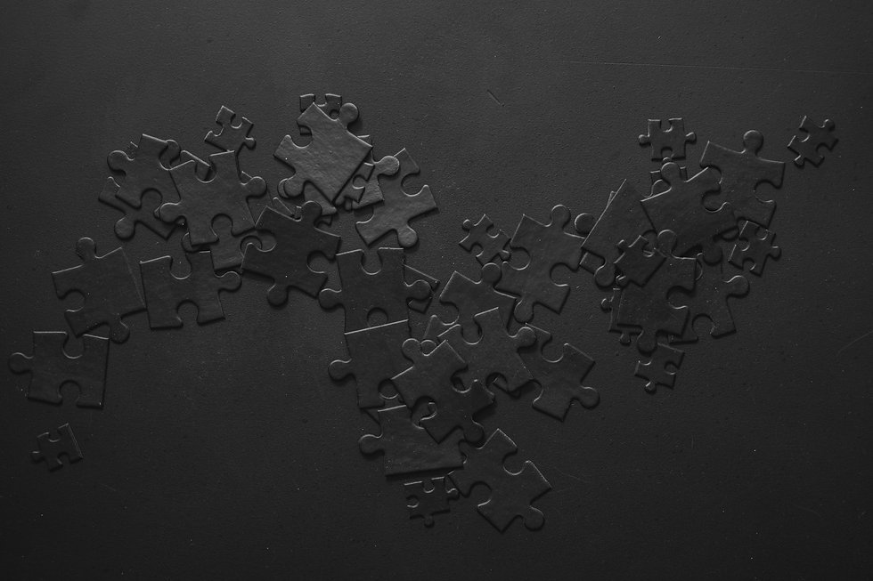 Photo of black puzzles on a black backgr
