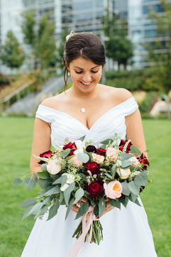 Bride with bouquet gorgeous outdoor wedding