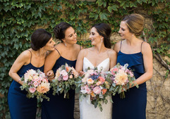 Bridal party holding beauitful floral bouquets