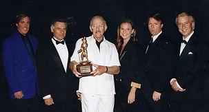Paul Winchell accepting lifetime award at Vegas Ventriloquist Convention  Award 1997jpg