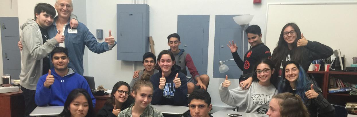 kids-classroom-hugging-teacher.JPG