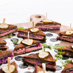 Mini reubens, pastrami, sauerkraut, Russian dressing, pickles, swiss cheese