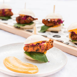 Mini chicken bao, fried chicken thigh, purple cabbage, Szechuan slaw 6 black vinegar glaze, spicy miso Kewpie