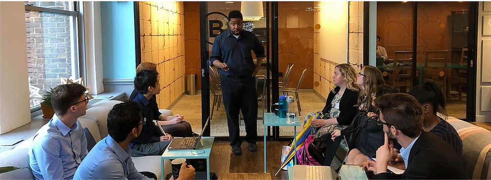 (2018-  Marcellus Henderson At the (42nd street weworks) Nonviolence  International New York Office running a training session before the  team's head off to the United Nations to do their work in the General  Assembly)