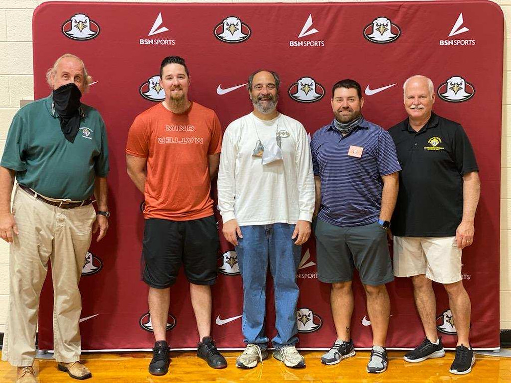 Volunteers helping with the Knights of Columbus Council 5207 Annual Free Throw Championship at the Sacred Heart Cathedral School.