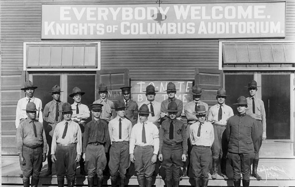 A group of Knights of Columbus secretaries are pictured outside of a K of C Hut at Camp Zachary Taylor in Kentucky in 1918.