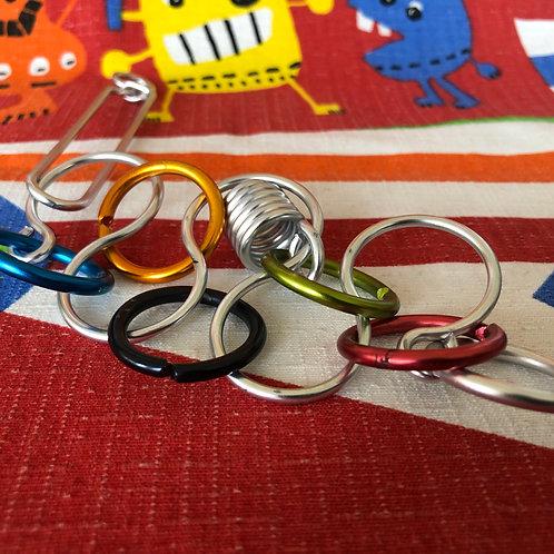 Puzzle de alambre color aros