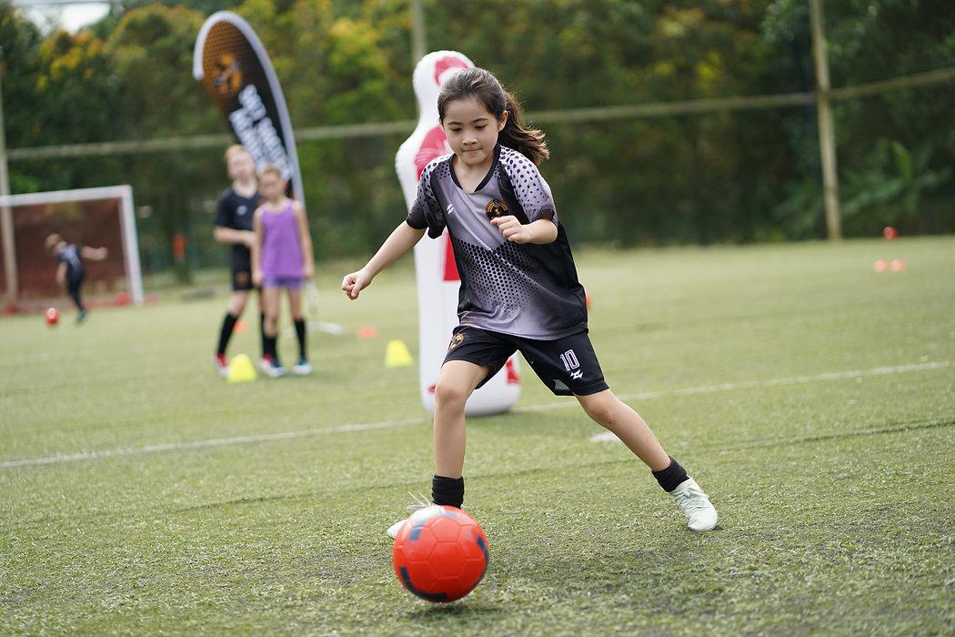 sg7 soccer academy girl playing ball